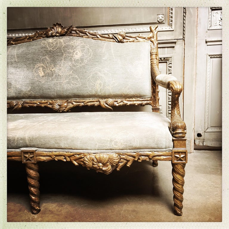 A carved wood grotto style sofa with a metal leaf finish. This sofa is very comfortable and is not an antique.