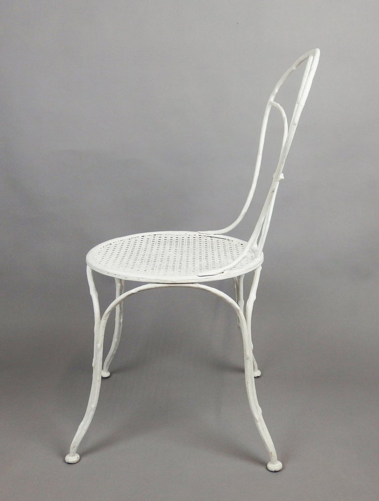 A branches shaped, white enameled cast iron chair, made by