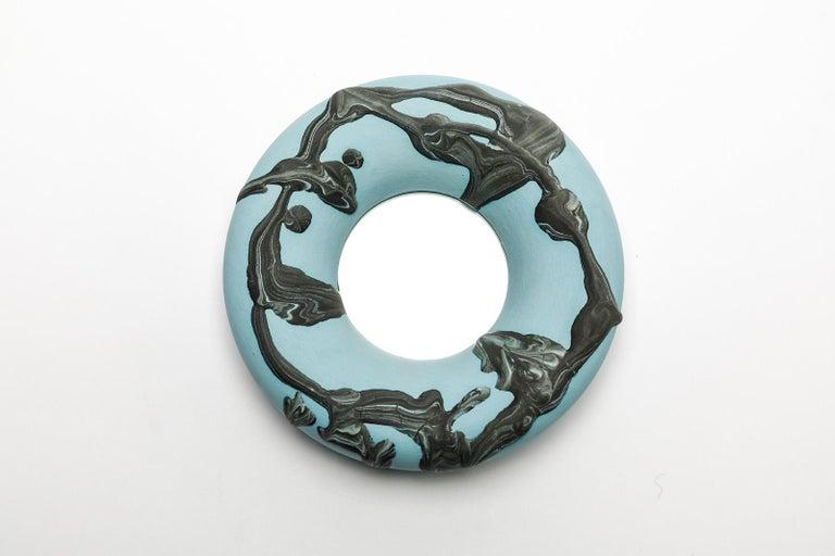 A ceramic mirror with blue and dark green glazes decoration by Mia Jensen. Unique piece. Signed under the base. Unique piece, circa 2019.