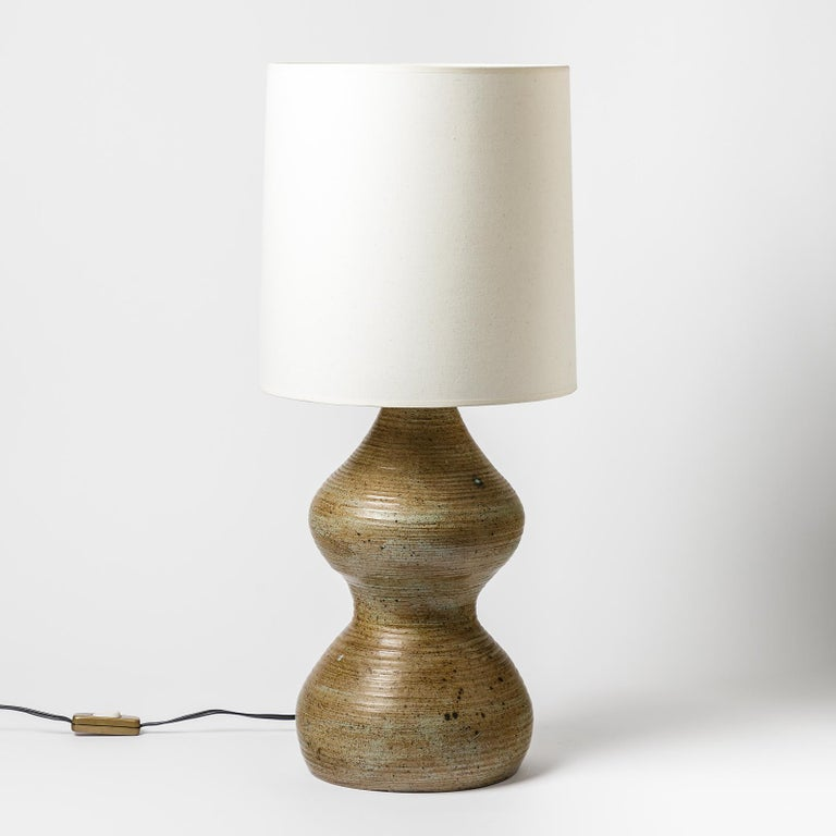 A ceramic table lamp, signed under the base