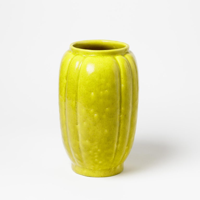 An Art Deco ceramic vase with yellow glaze decoration by Raoul Lachenal. Perfect original conditions. Signed