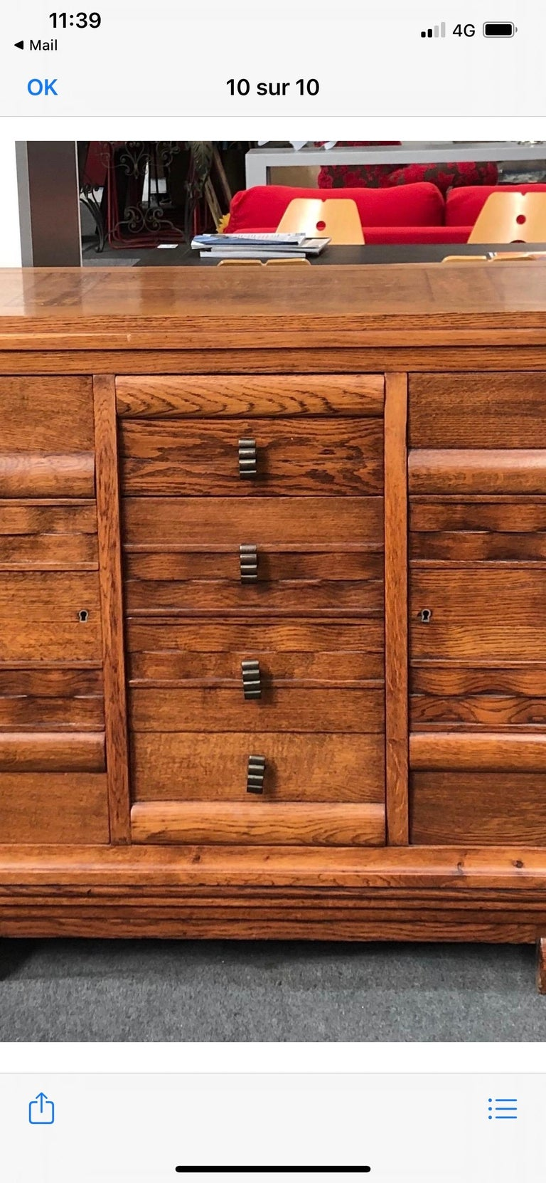 An oak sideboard by Charles Dudouyt.