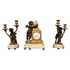 A Charming French Bronze & Ormolu Cherub Clock Garniture