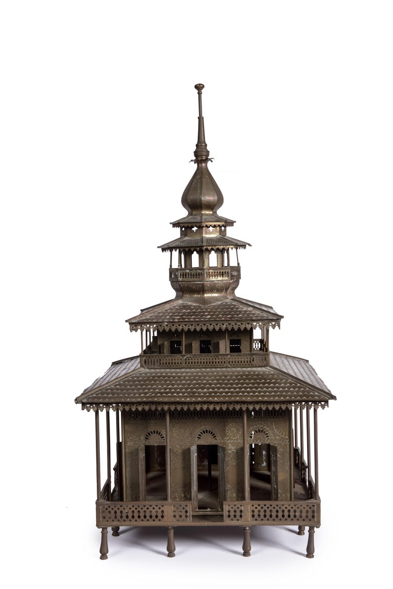 A charming Indonesian brass and copper Indonesian miniature Mosque  Late 19th/early 20th century  The building with three layers above the central praying-room, a minarett on top, all doors and windows fully functioning.  Measure: H. approx.