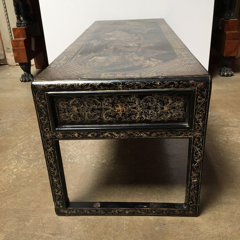 A Chinese lacquered low table.