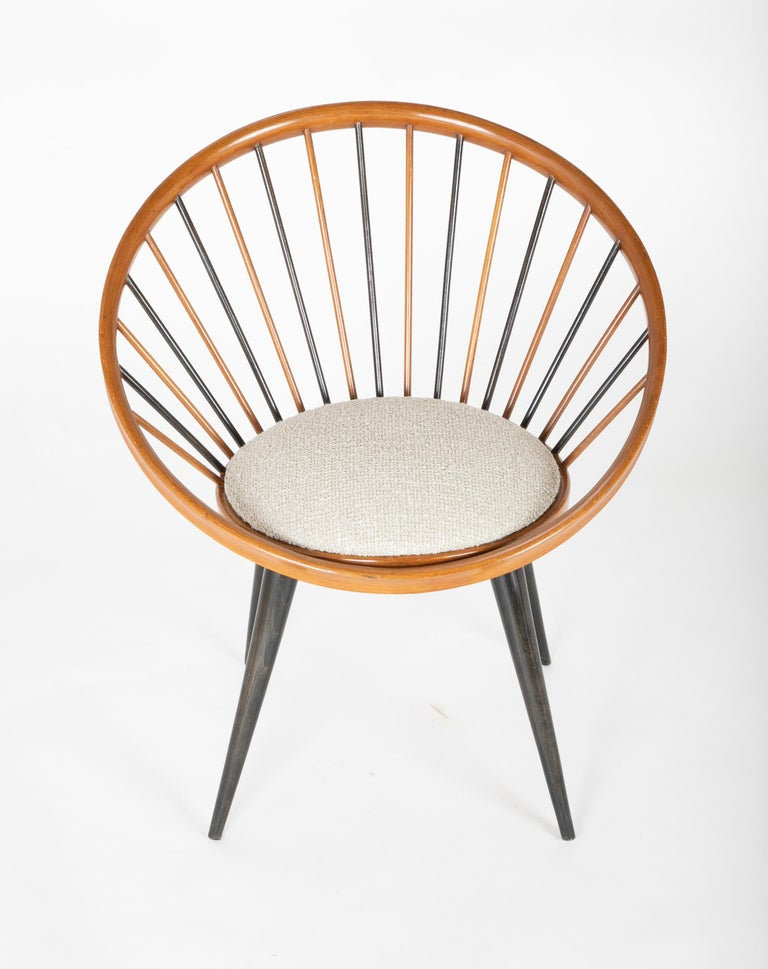 A chair designed by Yngve Ekstrom circa 1960. Rising from ebonized legs the blond Birch wood chair has alternating black and blond spindles.