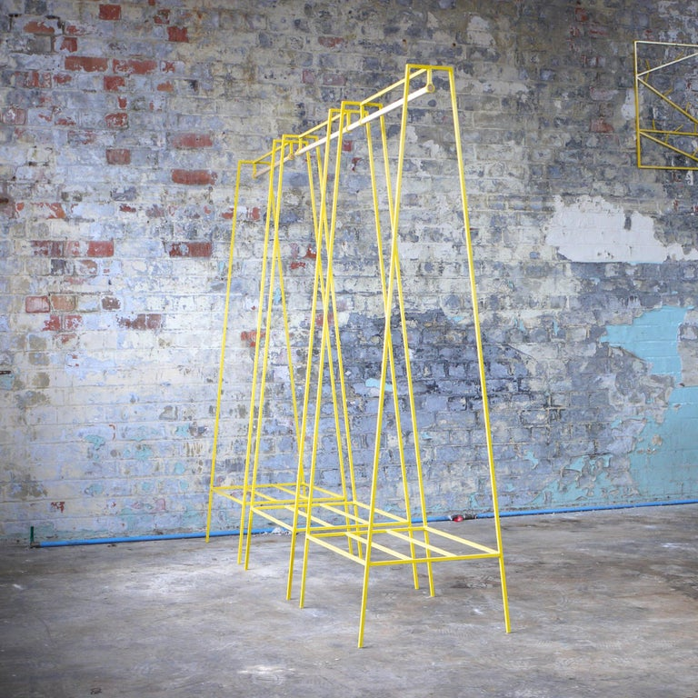 The steel slimline 'A' clothes rail is one of &New's signature pieces. A stunning addition to any bedroom or hallway, the minimal design looks delicate but is surprisingly robust. This one is powder coated in yellow, but the clothes rail comes in