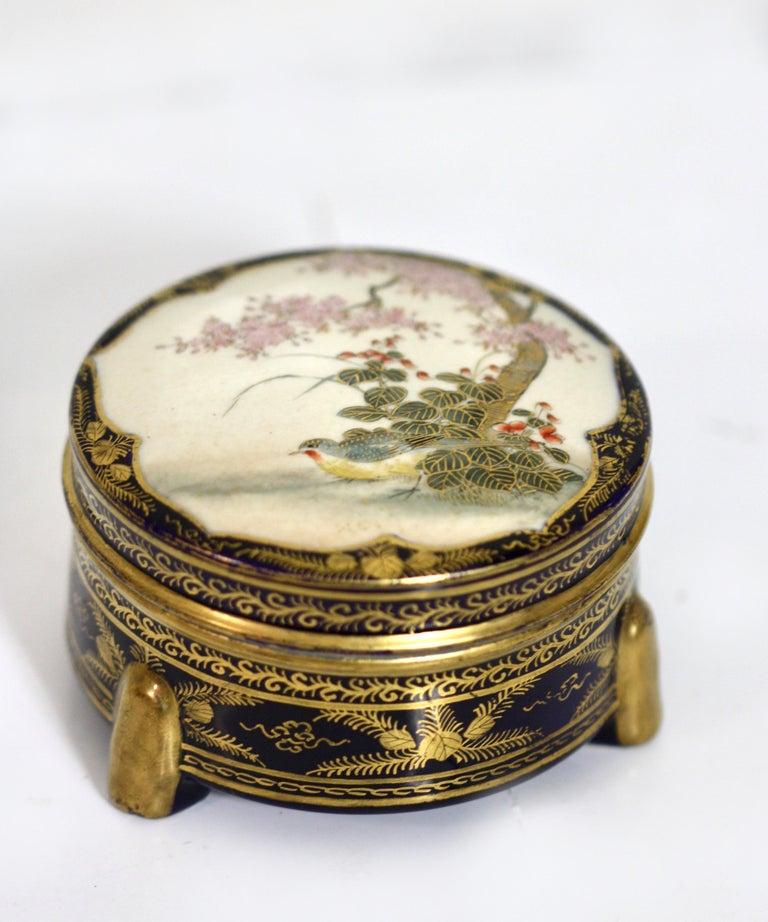 A collection of five signed antique Satsuma miniatures, each an example of the variant Satsuma studios; from the graduated color of Tozan, to the gilded cobalt of Kinkozan, and a tripod koro (incense burner) by Matsumoto Provenance: Midori