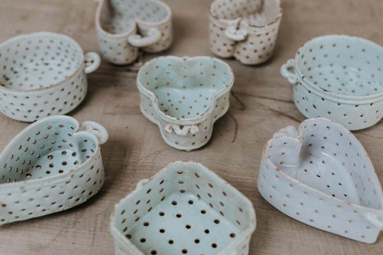 This is a collection of 8 French 18th century porcelain soft cheese moulds, collected by a French antiques dealer over 35 years time,