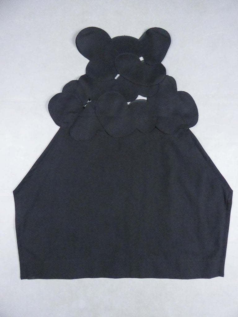 Circa 2000 France Japan  Iconic black chasuble dress byComme des Garçons from the famous Japanese brand created by Rei Kawakubo. Master in the art of deconstruction in fashion, Junya Watanabe presents here an architectural and asymmetrical dress
