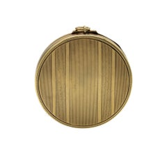 Compact of Textured Gold Patterns, Opening to Reveal a Fitted Mirror