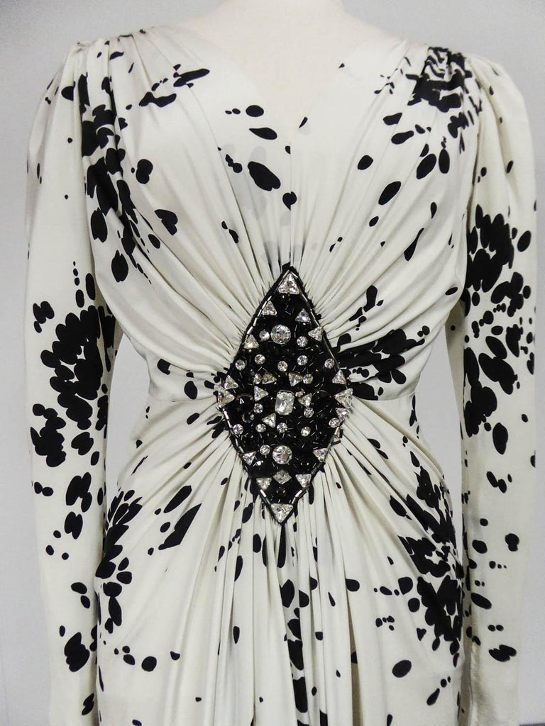 Circa 1984 France  Haute Couture evening dress attributed to Yves Saint Laurent from the 80s. Printed silk crepe (Maison Abraham?) of splash of black paint on a immaculate white background. Astonishing work of pleated drapery from a large medallion