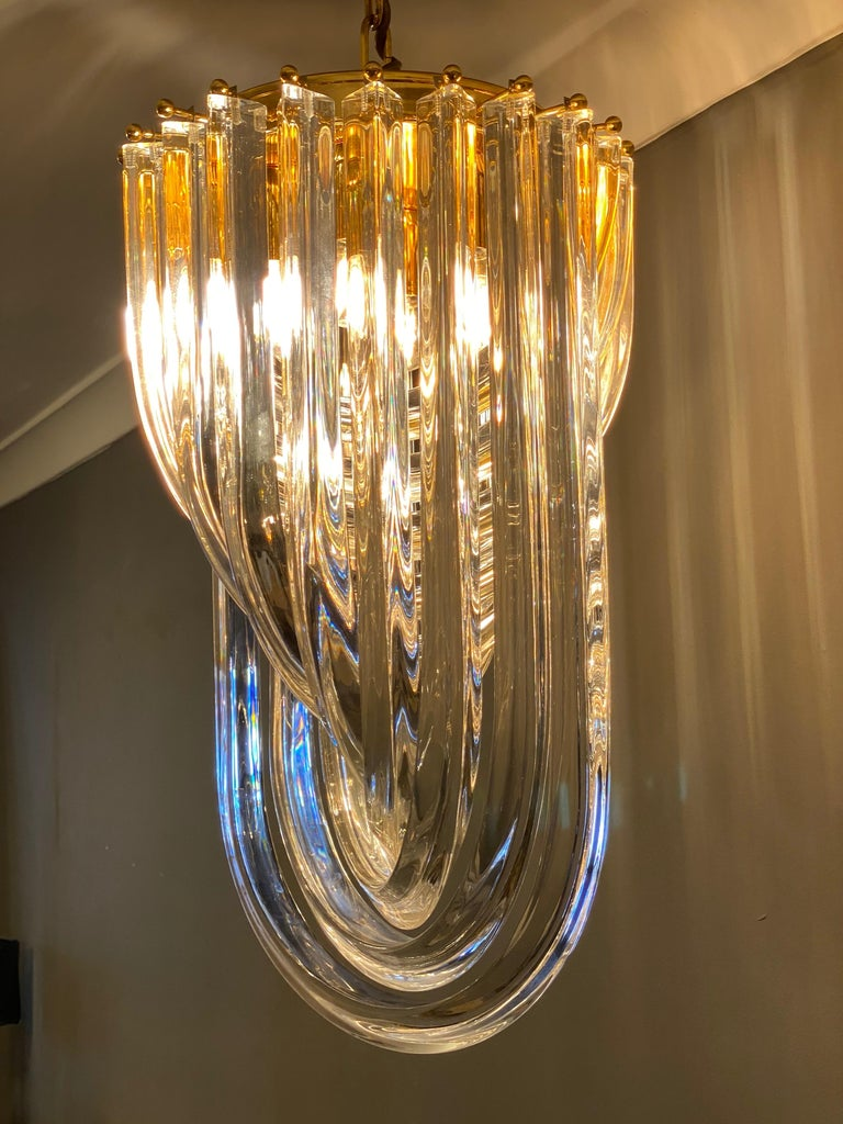 A Murano curved glass chandelier with brass frame, by Industria Veneziana designed by Carlo Nason in the 1970s. This is a late 1980s model in good order and fantastic quality, by a recognised Italian manufacturer in Venice.