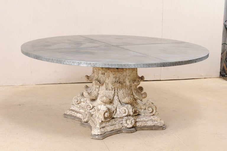 A custom zinc top table a custom zinc top and early 20th century capital base dining table. This fabulous custom table has been fashioned from the base of an antique American plaster and terracotta column, heavily adorn in acanthus leaf motif,