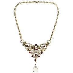 A demi-lune, gilt metal and paste 'Clair de Lune' necklace, Trifari, USA, 1950s