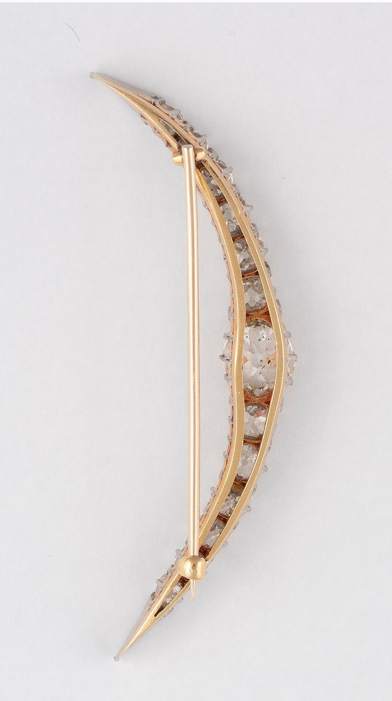 The half-moon brooch, pavé-set through out with cushion-shaped and rose-cut diamonds, cushion-shaped diamonds approx. 5.40cts total, length 7,5cm