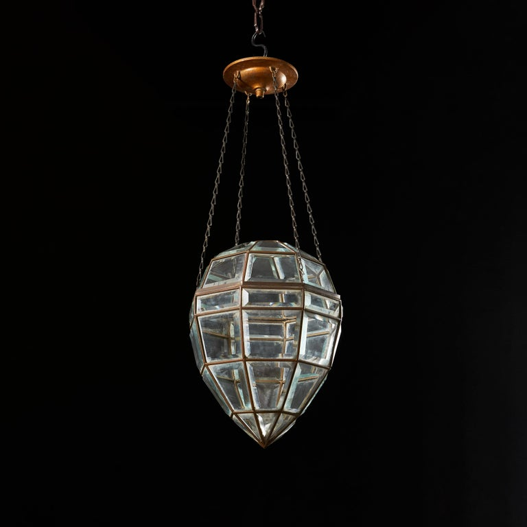 An early twentieth century glass pendant light in the form of a cut diamond, each panel of glass with beveled edges, sitting within a leaded frame.  Currently wired for the UK.  Measures: Height of pendant 32.00cm Overall height 60.00cm.