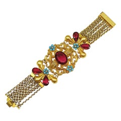 A dramatic wide gilt metal and paste bracelet, in a fitted box, c1900s