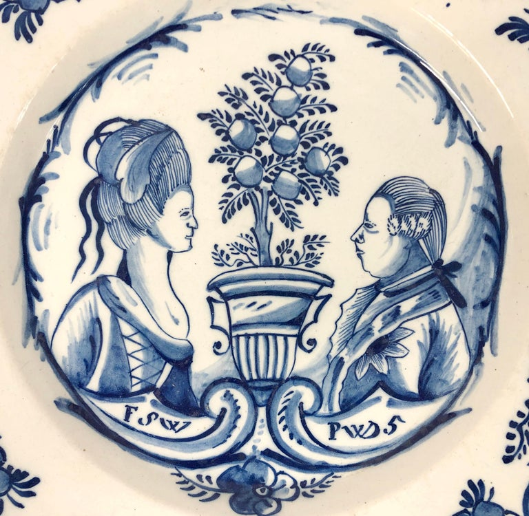 Painted in blue and white depicting the double portrait of