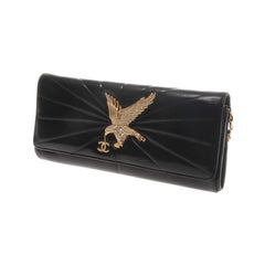 Chanel quilted black leather clutch with gold-tone hardware
