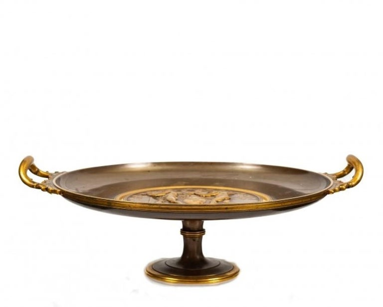 A fantastic Ferdinand Levillain Tazza (1837-1905), Paris, circa 1890. In the celebrated neo-Grec fasion, the tazza in gilt and patinated bronze, signed F. Levillain. Height 9 in.; Diameter 16 in. 22.8 cm; 40.6 cm catalogue note: The source of