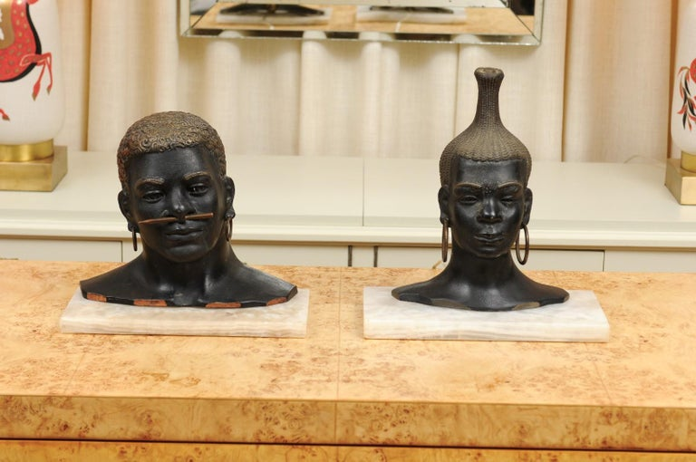 An exquisite pair of bronze tribal sculptures in the style of Franz Hagenauer, circa 1935. Incredible design, detail and craftsmanship. The pieces are mounted on a Marble base and back lit via a socket mounted in the rear. The figures may be removed
