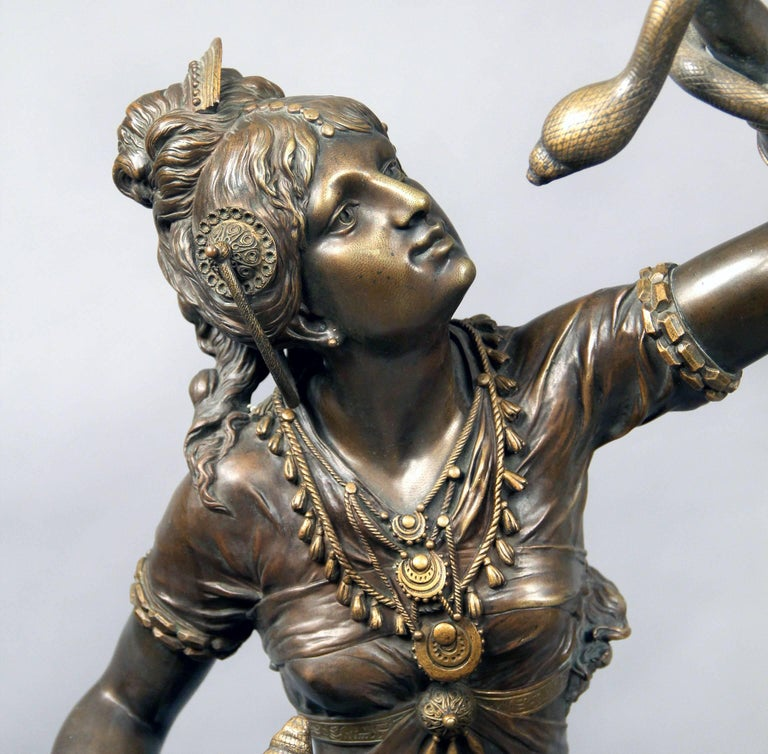 A fantastic quality late 19th century bronze sculpture of Cleopatra.  Signed Henri Plé.  The subject is based on the popular belief that when Cleopatra committed suicide by poisoning, it is that she was bitten by an asp.  Henri Honoré Plé was