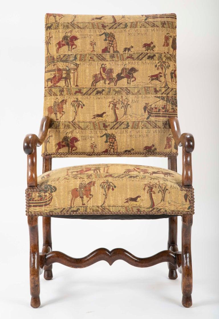 A French Louis XIII walnut armchair, circa 19th century.