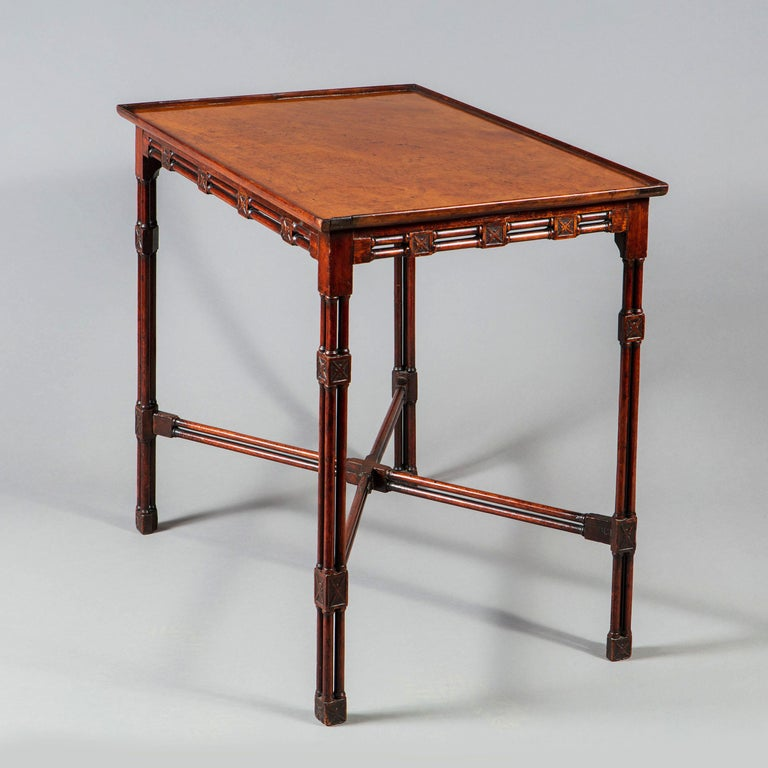 A fine and rare George III Chinese Chippendale mahogany silver table. Having cluster column legs with cruciform low relief ornament at the joints and an unusual double-column x frame stretcher.  England circa 1765  Provenance Frank