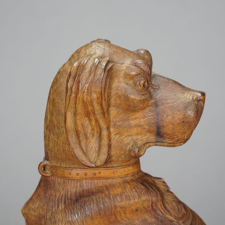 A wooden carved statue of a staghound. Carved as half relief out of one piece of nutwood. Brienz, Switzerland, circa 1920.
