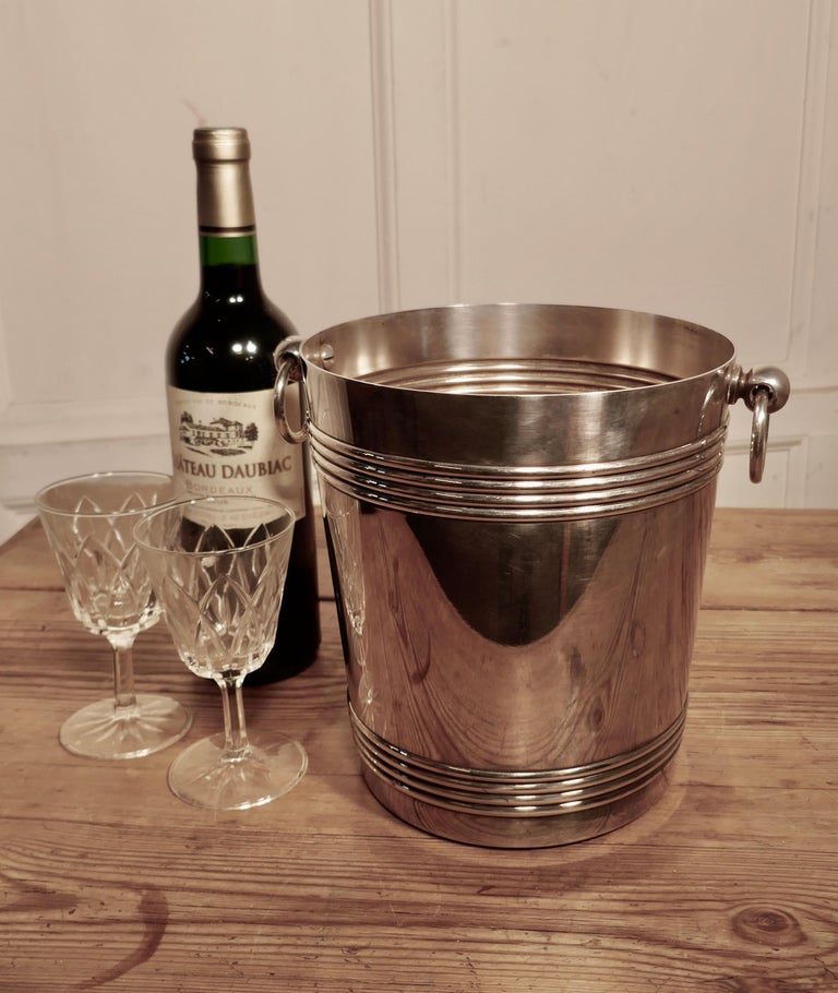 A fine French Art Deco style wine cooler, by Gallia  A very attractive vintage ice bucket in French silver plate by Galia, the cooler is straight sided, and has ring handles with a decorative reeding and around both top and bottom This ice bucket