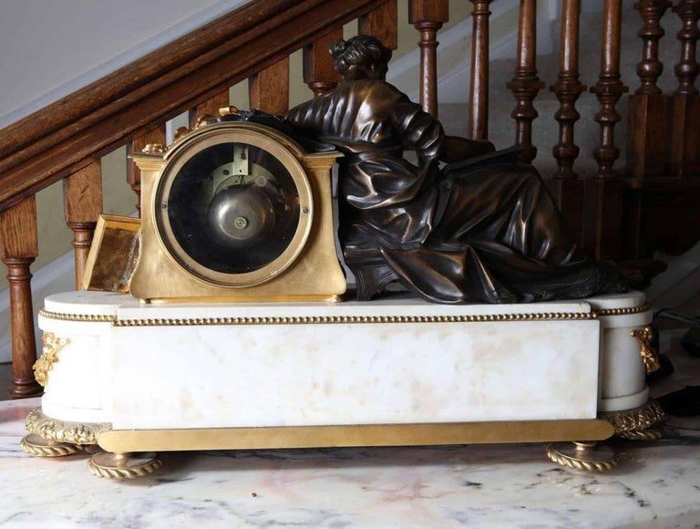 A fine late 19th century large white marble and ormolu mantel clock with a finely cast and patinated bronze lady reading.  The clock is in superb condition and has been restored by a specialist in French clocks. Striking every half hour and