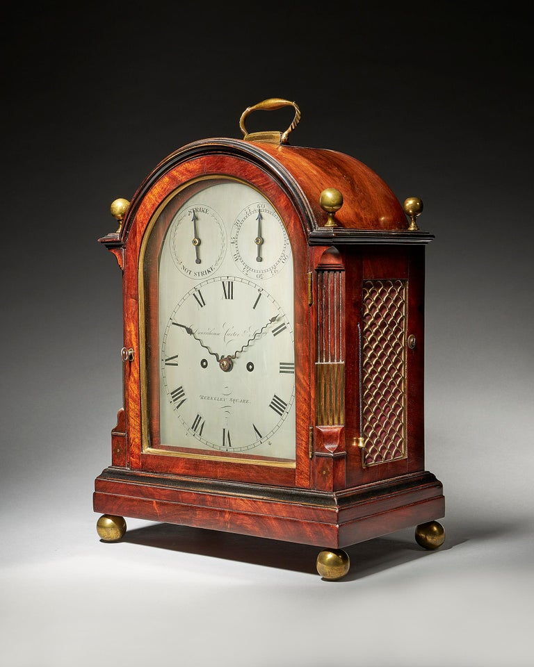 A fine George III eight-day striking mahogany bracket clock with trip repeat and silvered dial, by Dwerrihouse Carter & Son of Berkeley Square London, circa 1808-1815.   The eight-day twin fuse movement with trip repeat mechanism strikes on a bell