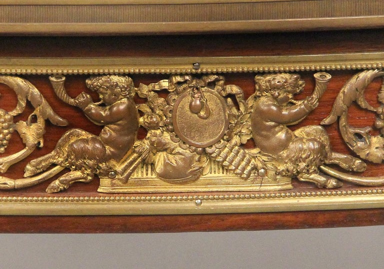 A fine late 19th century gilt bronze-mounted Louis XV style table