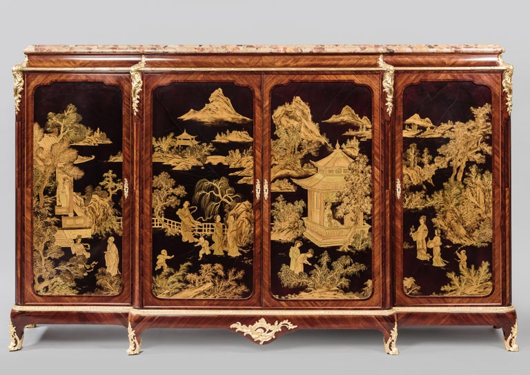 A Fine Louis XV Style Gilt-bronze Mounted Japanned Side Cabinet, With A Breche D'Alep Marble Top, By Henri Nelson, Paris.   French, circa 1900.   Stamped to the carcass 'H. Nelson'.   This elegant side cabinet is of shallow break front form, with a