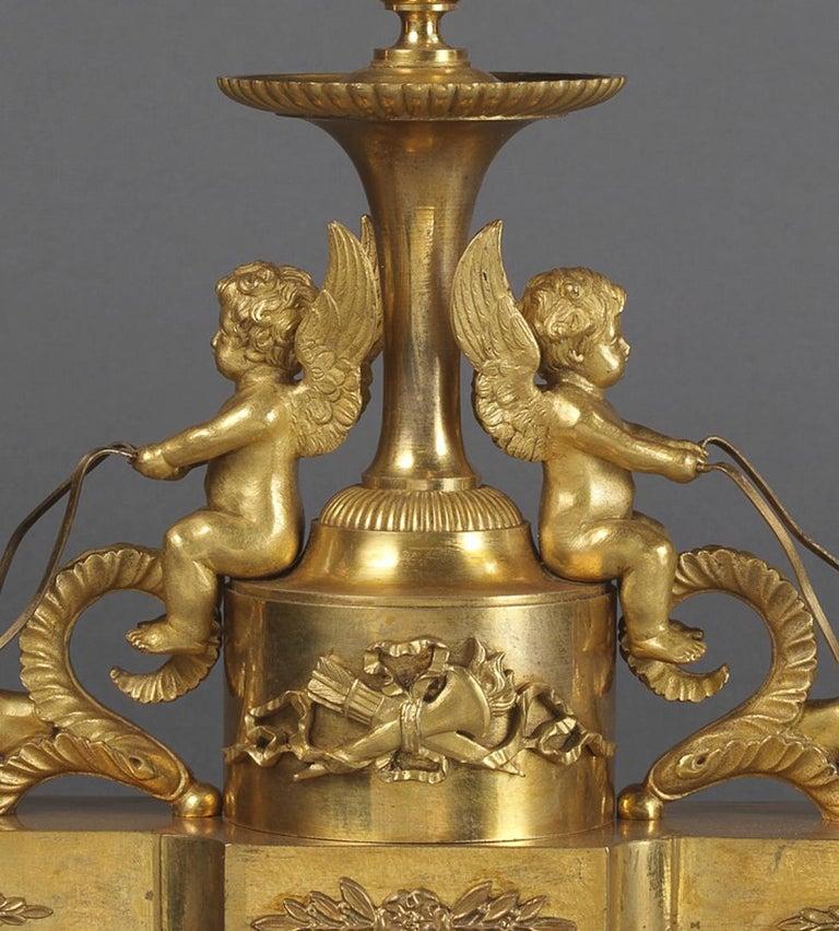 French Fine Louis XVI Style Gilt Bronze and Ebony Three-Light Desk Stand, circa 1820 For Sale
