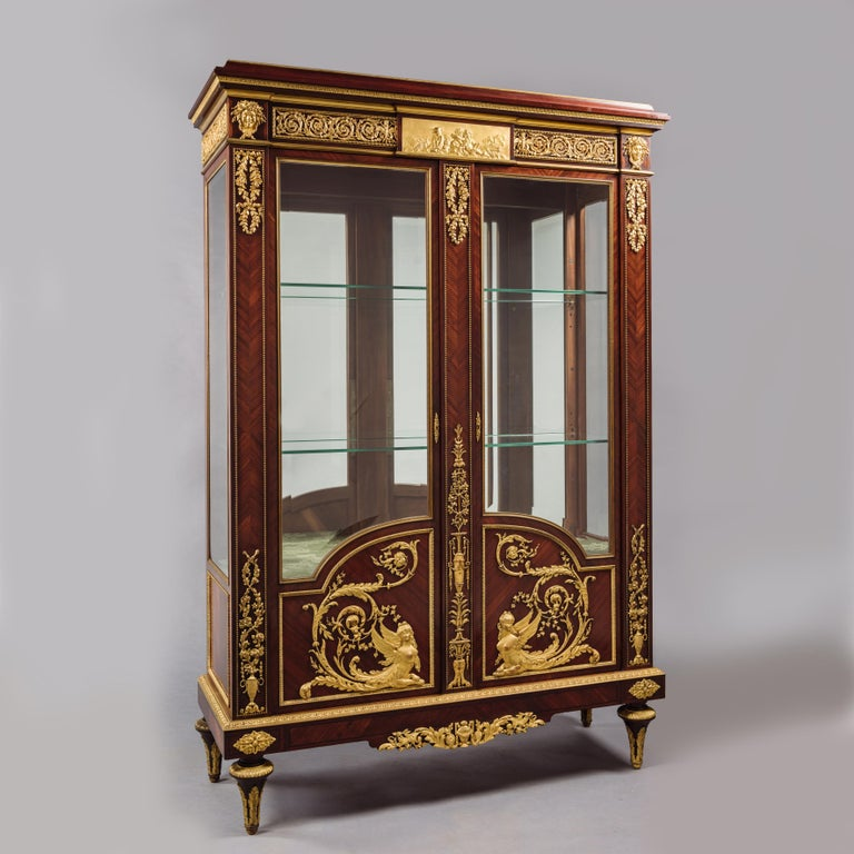 A fine Louis XVI style gilt-bronze mounted vitrine, The Bronze Mounts by Henri Picard.  Stamped 'P' to the reverse of the gilt-bronze mounts for Henri Picard.   This exceptional Louis XVI style vitrine is of sought after proportions and enriched