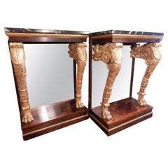 A fine pair of Regency rosewood and parcel gilt marble top consoles