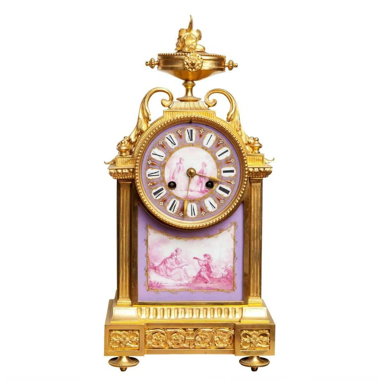 France, circa 1880  The ormolu case mounted with fine painted porcelain scenes of a courting couple. This unusual mauve colour pallet emphasizes the quality and cleanliness of the clock.  Strikes every half hour and hour.   Measures: Height