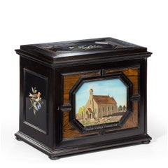 A fine quality ebony bijouterie table cabinet showing Cavalry Church, Stonington