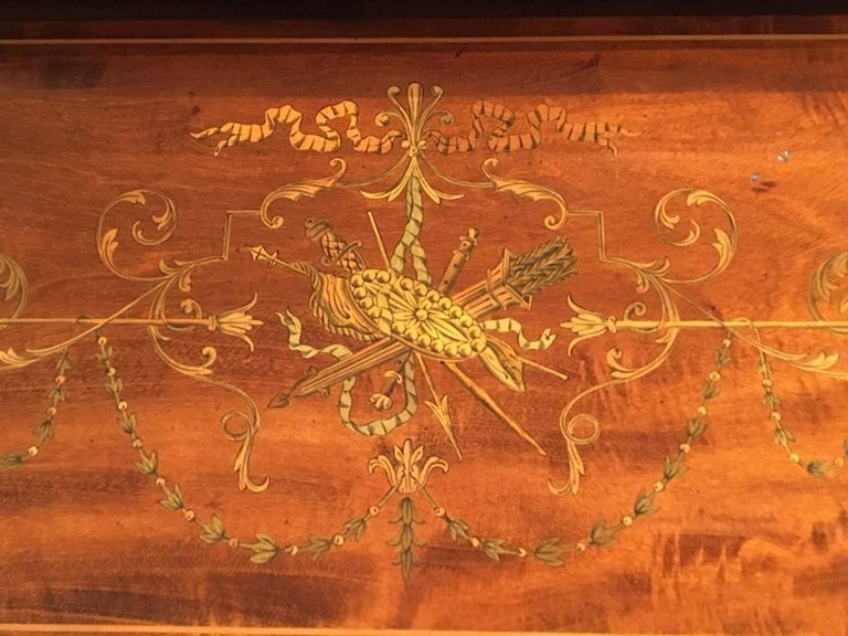 A fine quality mahogany inlaid Edwardian Period desk by Maple & Co. of London. Constructed using the finest figured mahogany throughout and having a brass gallery above the tambour front which opens automatically when the lower drawer is opened,