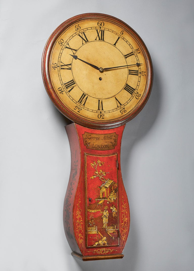 This fine late 18th century tavern clock with a circular white dial is beautifully decorated and signed under the dial on the trunk in a gilt cartouche George Allett London, circa 1780.  The red-japanned case of traditional style has a shaped