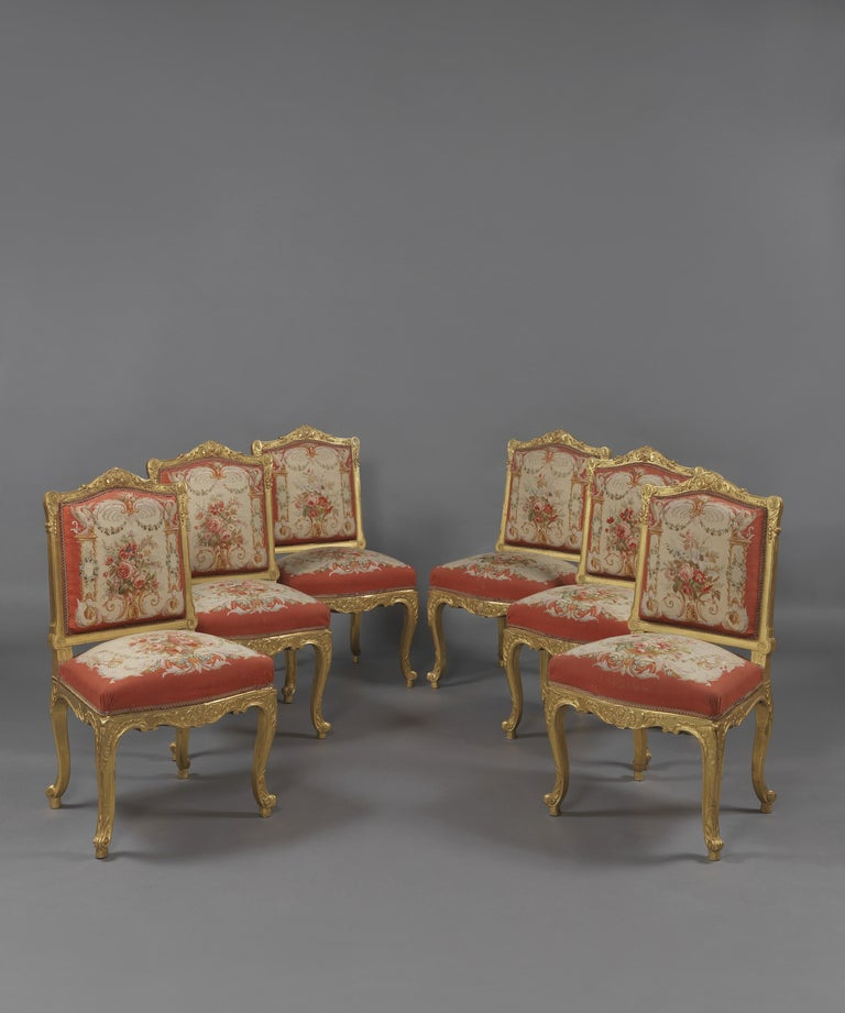 A fine set of six Louis XV style giltwood side-chairs upholstered in aubusson tapestry. 