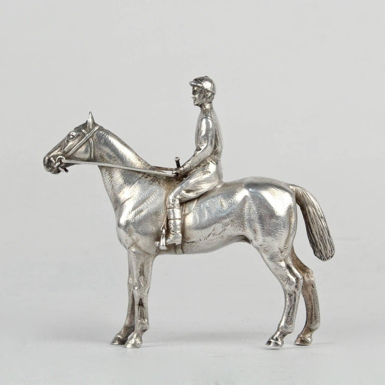 A very finely cast silver horse and jockey sculpture.   The horse and jockey are depicted at rest.  The sculpture is unmarked. We believe that the silver fineness is coin or sterling.  Simply a stunning miniature objet d'art!  Length: ca. 3