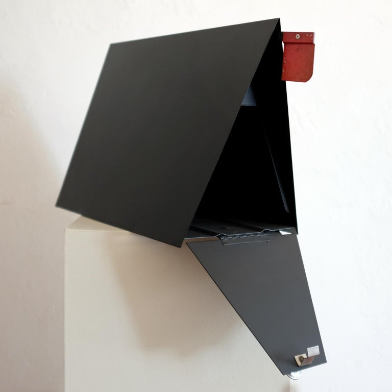 A-frame metal mailbox by Babco. Produced in the 1950s in Los Angeles California. It includes a retractable red flag to notify the postal carrier of outgoing mail.