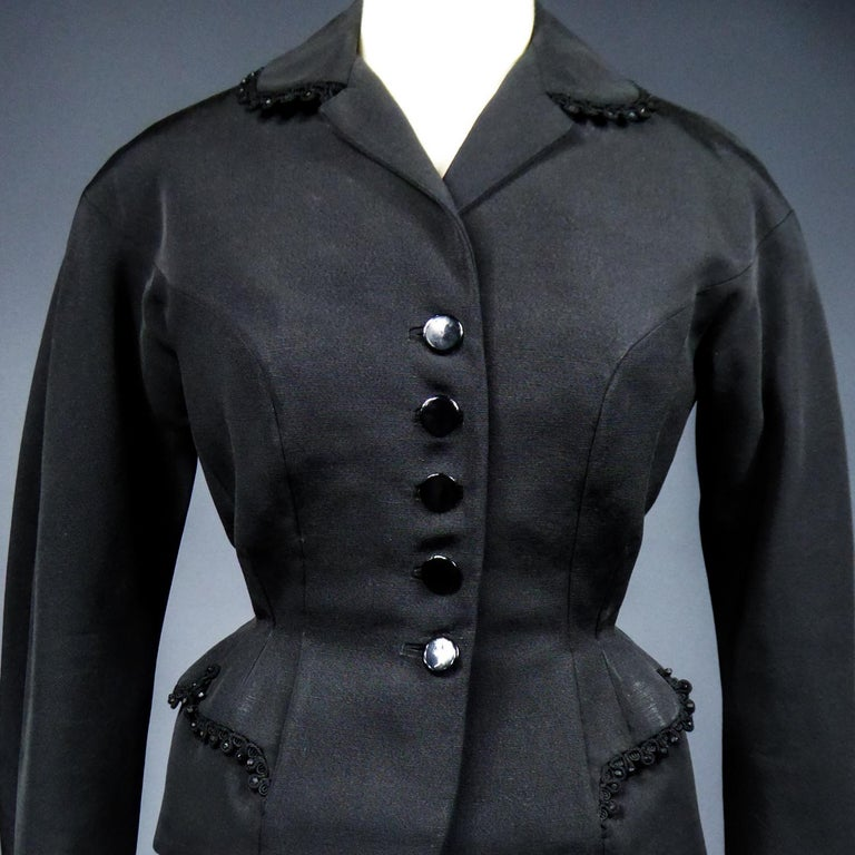 Circa 1948/1950 France  Bar jacket in black fluted silk ottoman labeled Frank & Fils in the tradition of the New Look of Christian Dior and dating back to the late 1950s. Fitted jacket with structured cut and marked waist marrying the hips. Cross