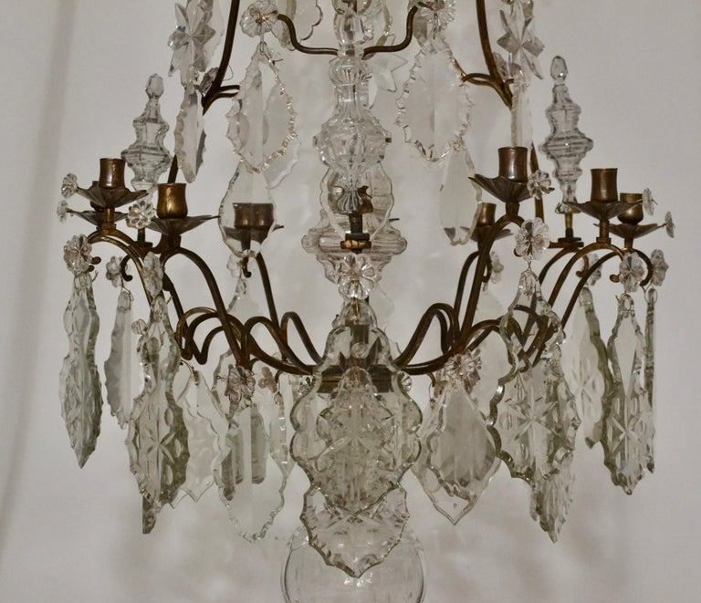 A very fine large French Louis XV eight-light 18th century rococo chandelier. Gilt bronze and crystals. The bronze with a dark patina and original feeling. All crystals from the period.