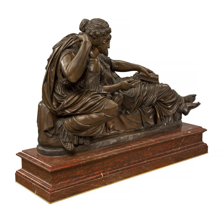 A monumental and extremely high quality French 19th century Louis XVI style patinated bronze and Rouge Griotte marble statue of