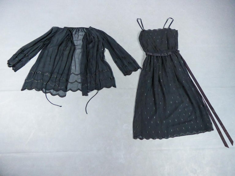 Circa 1980/1990 France  Dress and jacket set in black chiffon embroidered with fine patterns by Christian Dior dating back to the 1980s. Probably from Mister Marc Bohan or Gianfranco Ferré (?). Blouse in black chiffon with pagoda sleeves and loose