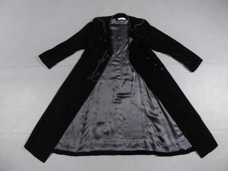 Circa 1976 France  Little black dress in velvet panne by Emanuel Ungaro Haute Couture numbered 4383-10-76 from the 1976 Collection of the famous Couturier. In line with the inspiration of Yves Saint Laurent's Ballets Russes, this dress is open in
